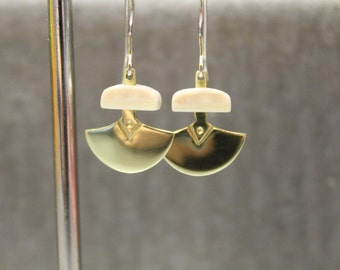 Inuit have carved ivory and brass ulu earrings