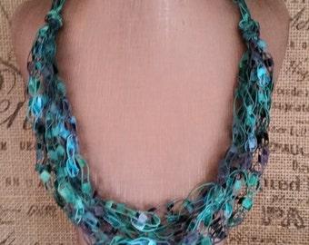 Yarn Necklace - Crocheted ladder/ribbon yarn in Emerald Green & Grey