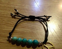 Mineral stones and peace symbol bracelet