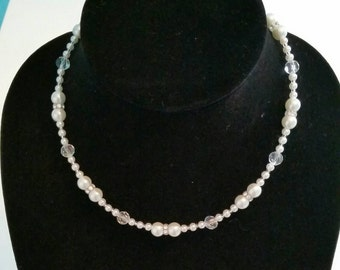 White glass pearl beaded necklace with glass seed beads and Swarovski rhinestones.