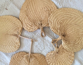 five vintage straw fans, with hooks for hanging, various sizes