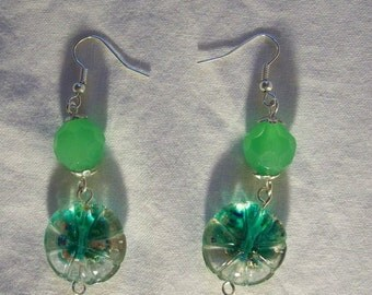 Hand made earrings with green glass beads