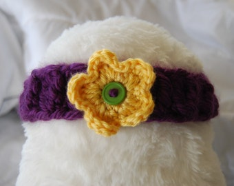 Purple ladder headband with yellow flower and green button