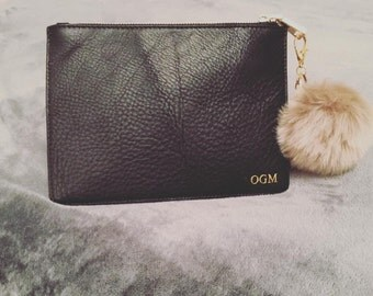 Small leather clutch bag