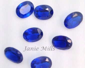 Sapphire faceted gemstone, 6 x 8mm oval