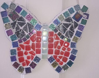 Butterfly garden decoration. Glitzy, sparkly and gorgeous. On slate, plain slate back so you can use chalk in it.