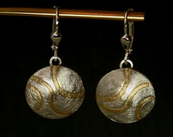 Earrings made of silver and gold