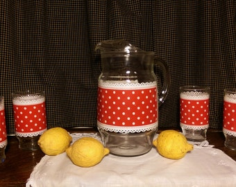 Red and white polka dot pitcher and glasses
