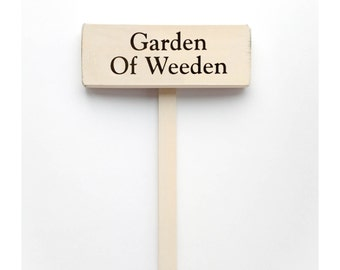 """Garden Stake Sign Saying """"Garden of Weeden""""  White Wood Sign With Saying in Black Lettering."""