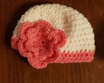 Crochet newborn hat with flower