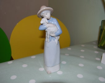 Lovely 1990s Rex Valencia figurine of girl holding lamb | Free worldwide delivery