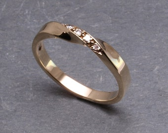 9ct gold diamond twist ring.