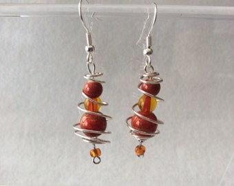 Orange and silver spiral earrings