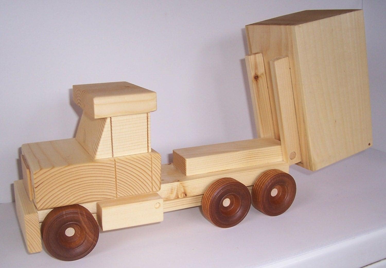Handmade wooden toy dump truck.