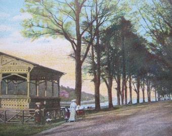 Woman walking on tree lined street / Vintage Irish postcard / Emerald series postcard