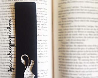 Black and white swan cut out bookmark.
