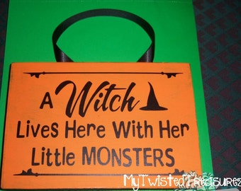 A Witch Lives Here With Her Little Monsters Wooden Sign