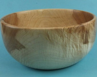 Very curly green turned maple bowl