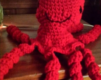 Red octopus crocheted animal