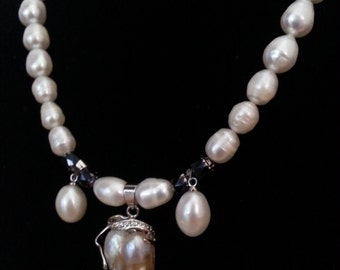 Genuine freshwater pearl necklace with three dangle pearl pendants.
