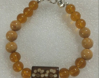 Mottled Riverstone and Dark Goldenrod Beaded Bracelet