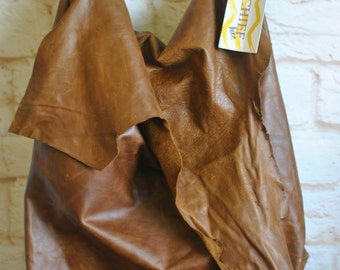 Raw edge carry on leather bag
