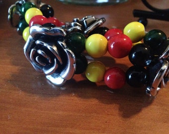 Two strand RASTA love elastic bracelet with large antique silver flowers