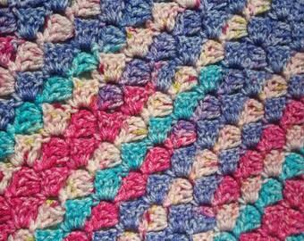 Eyecatching multicoloured Crib/pram Blanket