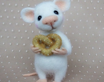 White fluffy mouse with pretzel