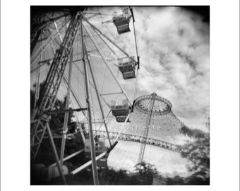 Ferris wheel and rides in black and white Holga image