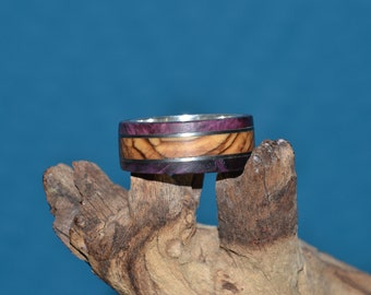 silver ring with olive wood, maple burl and titanium bands