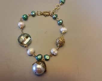Vintage style Bracelet with White and aqua Freshwater Pearls and Glass bead and goltone accents.