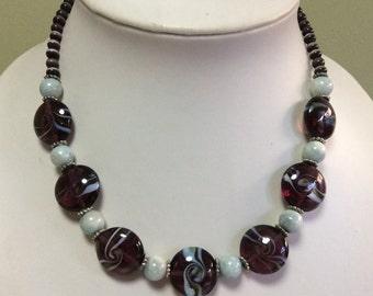 Puffed purple swirls necklace