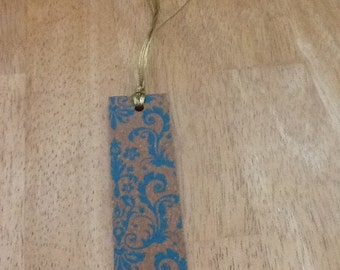 "6"" handmade bookmark with gold colored string"