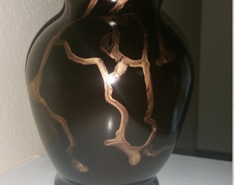 Elegant black and gold vase
