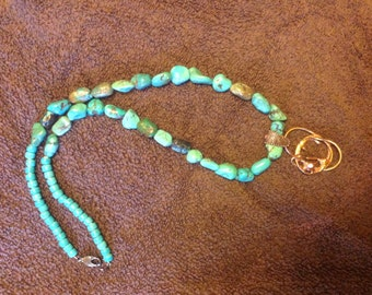 Turquoise necklace with free form copper pendant