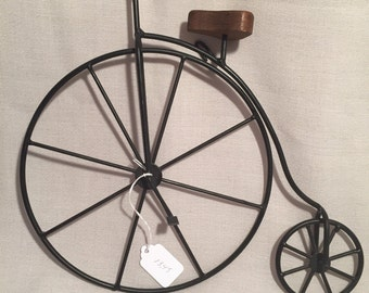 Black antique look two wheel bicycle wall hanging