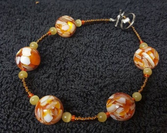 Handmade 8 Inch, Orange, Brown, and Yellow Catseye Glass Beaded Bracelet
