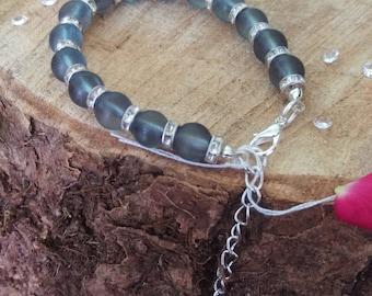 A smoky grey glass bracelet