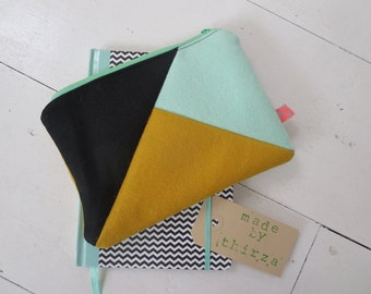 100% hand made pouch of wool felt, mint, ochre, black