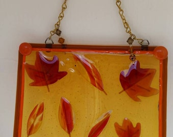 Beautiful suncatcher of leaves and acorns in gold, orange and brown hues.