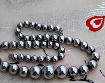 SALE:  Graduated Metal Silver Tone Bead Necklace/Signed Korea