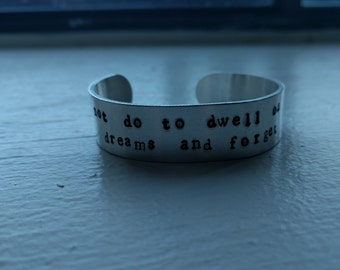 It Does Not Do to Dwell On Dreams and Forget to Live, Albus Dumbledore Quote, Metal Stamped Aluminum Cuff Bracelet