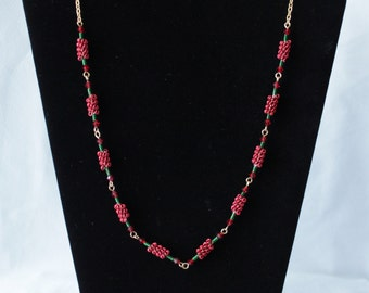 A Green and Red Coiled Wire Necklace and Matching Earring Set in Wire Work with Red Beads. Finished with a Gold Coloured Chain.