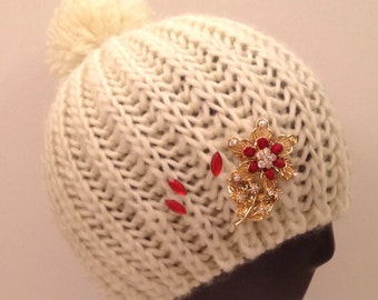 Ivory beanie bedazzled/decorated with red pin & accents