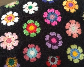 Beautiful hand crochet granny lapghan/throw.