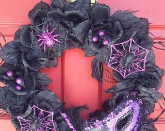 Glamorous black rose Halloween wreath with sparkling purple details