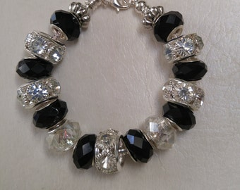 Cyndy: Black and Clear faceted glass beads with large rhinestone spacers. SimplyElegantKathy