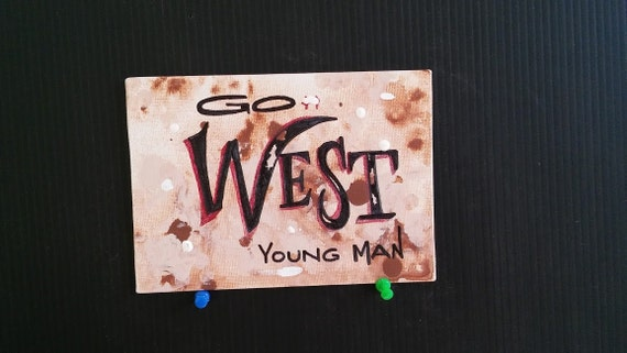 Whimsical western go west young man lettering on canvas panel wall hanging browns and beige