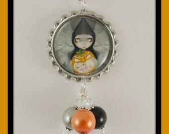 """Jasmine Becket-Griffith """"Born of a Pumpkin"""" bottlecap necklace"""